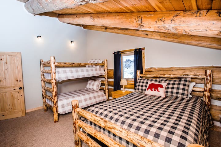 One upstairs bedroom has a queen log bed, and a bunk perfect for a small family.