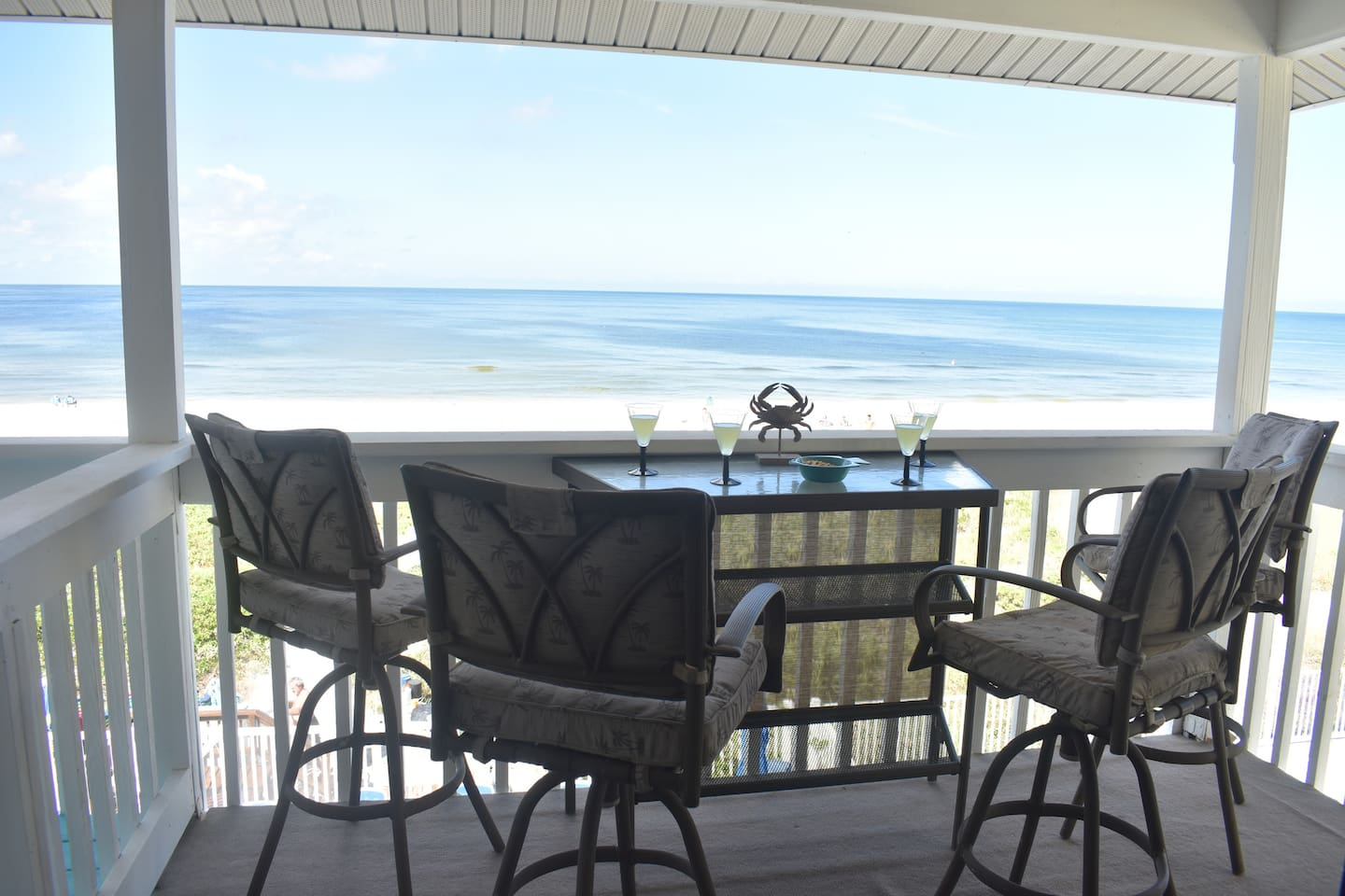 Furnished balcony overlooks the swimming pool and the Gulf!