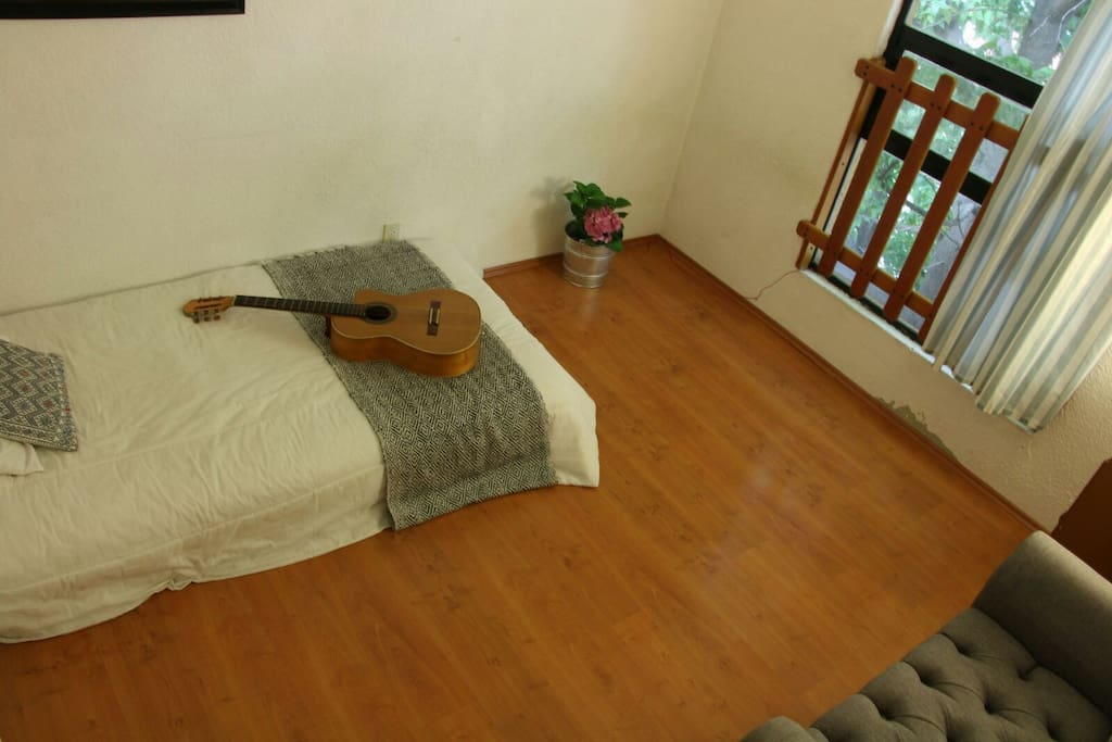 bohemian light, this is the same bedroom but with the bed in the other corner :) you can choose!!!