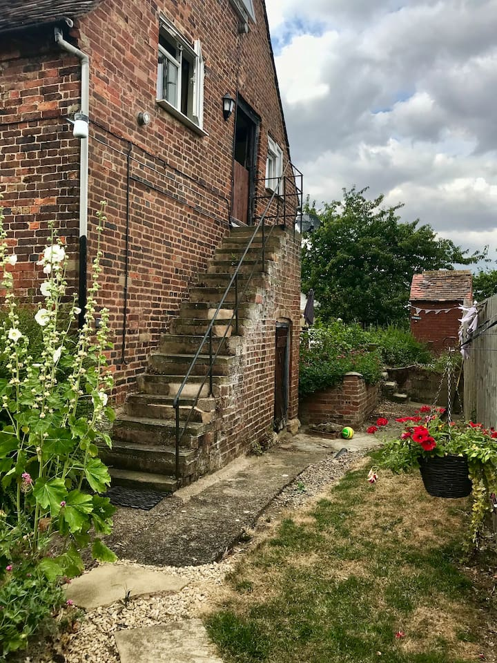 Outside of the granary, stone steps leading up to the front door