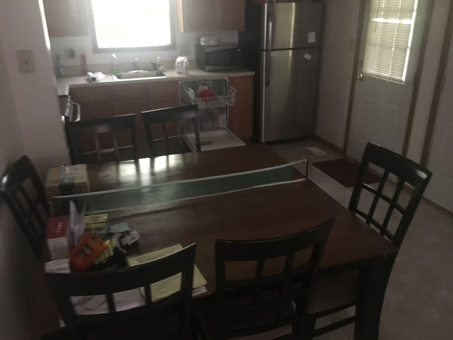 Full kitchen and dining area / table.