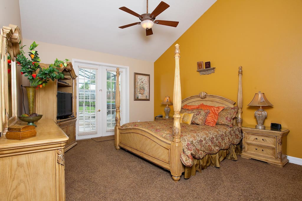 Gorgeous downstairs king suite 1 with French door pool access and LCD TV/DVD combo