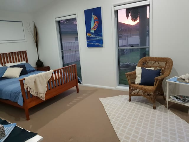 Bedroom 1, with access to bathroom and outside deck area