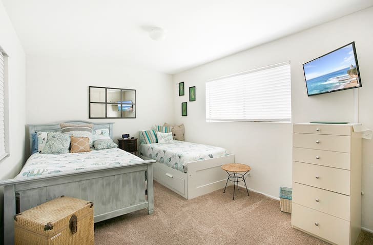 Bedroom 3  1 Full size bed 1 Twin bed Smart TV Ensuite bathroom This room is great if you have children joining you.