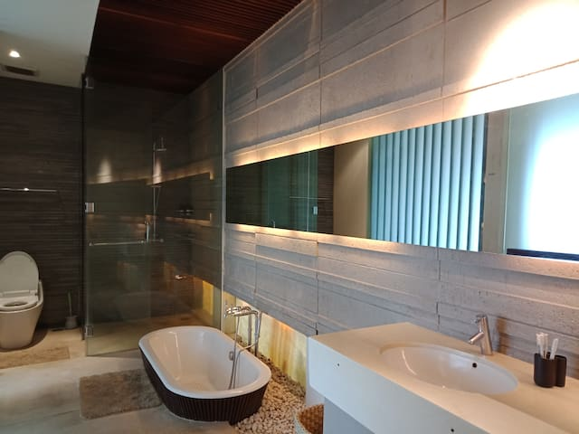 Spacious bathroom with bathtub and shower