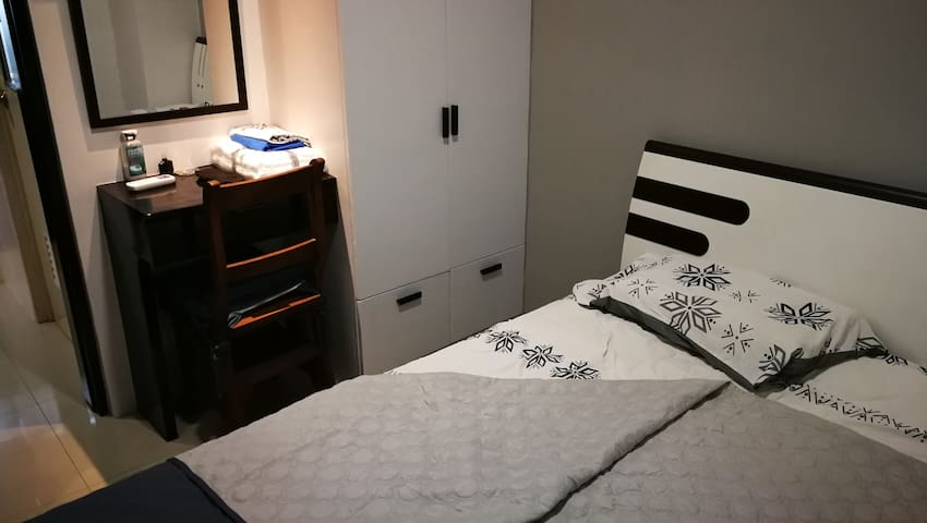 Bed, dresser, cabinet.