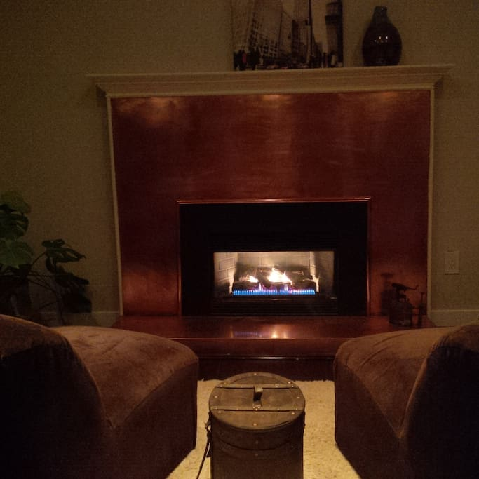 The copper fireplace at the foot of your bed.