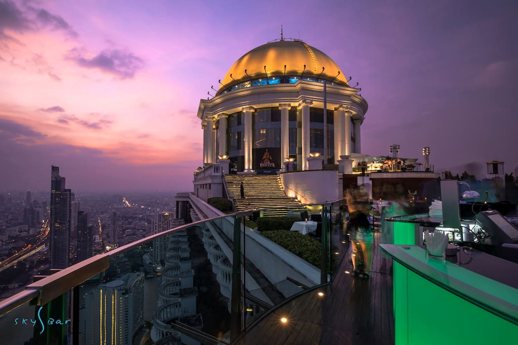 Suspended on a precipice over the city 820 feet in the air, Sky Bar is one of the highest rooftop bar in the world and, along with Distil bar one flight up, reinvents Bangkok's cocktail culture nightly. Open: 18:00 - 01:00 daily