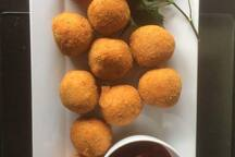 Amazing homestyle Arancini balls avaiable in vegetarian or bolognese
