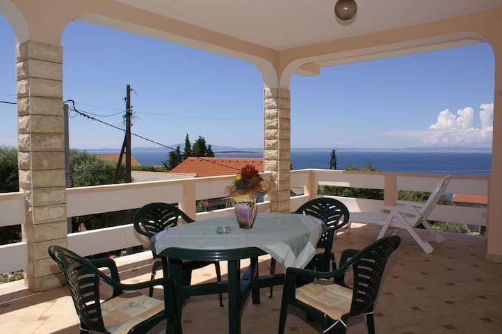 Two bedroom apartment with terrace and sea view Lun (Pag) (A-4062-a)