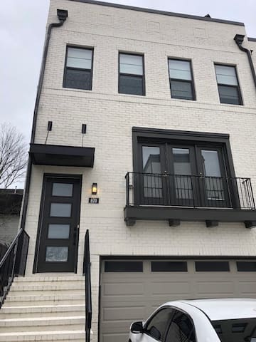 The front of your modern retreat - end unit on cul-de-sac.