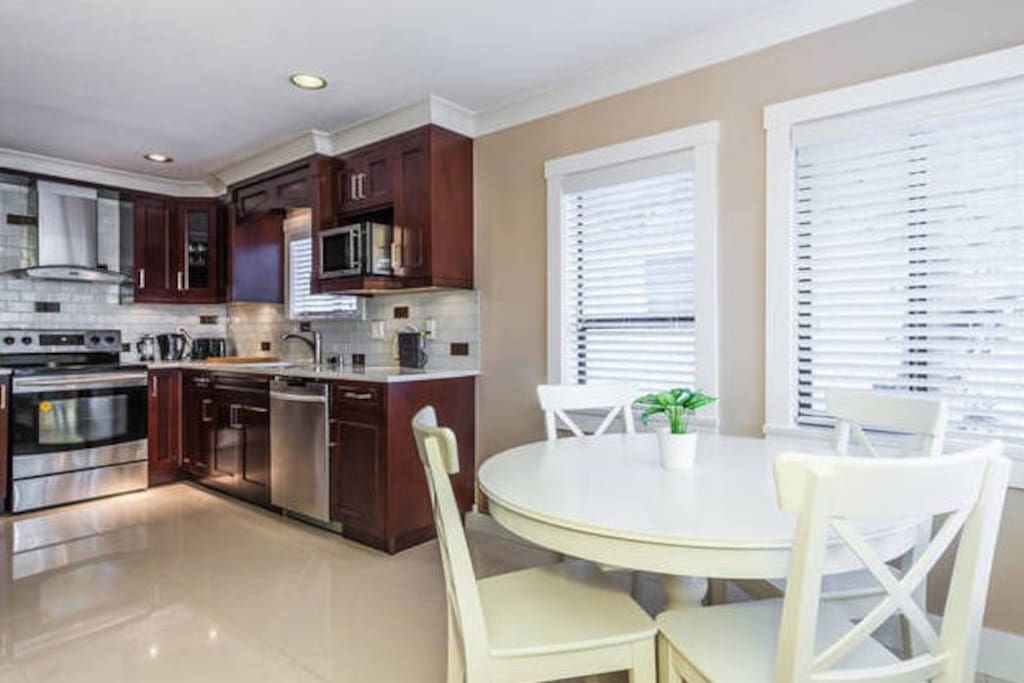 Kitchen with stainless steel appliances and eat in breakfast nook