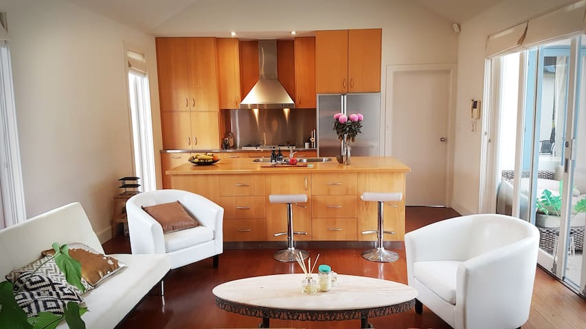 Guests make full access of the shared open plan kitchen, with gas cooking and Nespresso coffee maker.