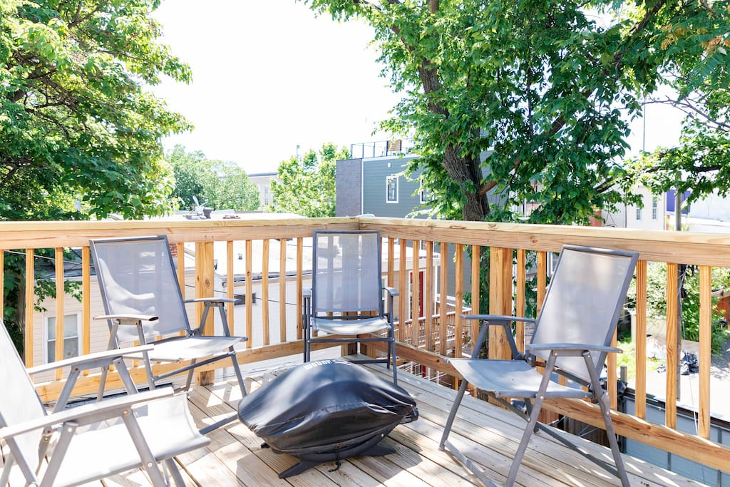 Enjoy the 2nd floor wooden balcony with grill