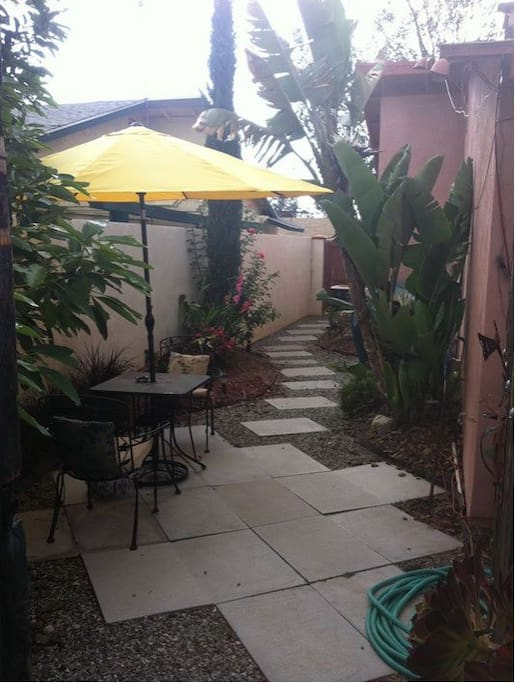 Large, completely private patio space, belonging to YOU...  pathway leads to lit parking space.  Come and go anytime!