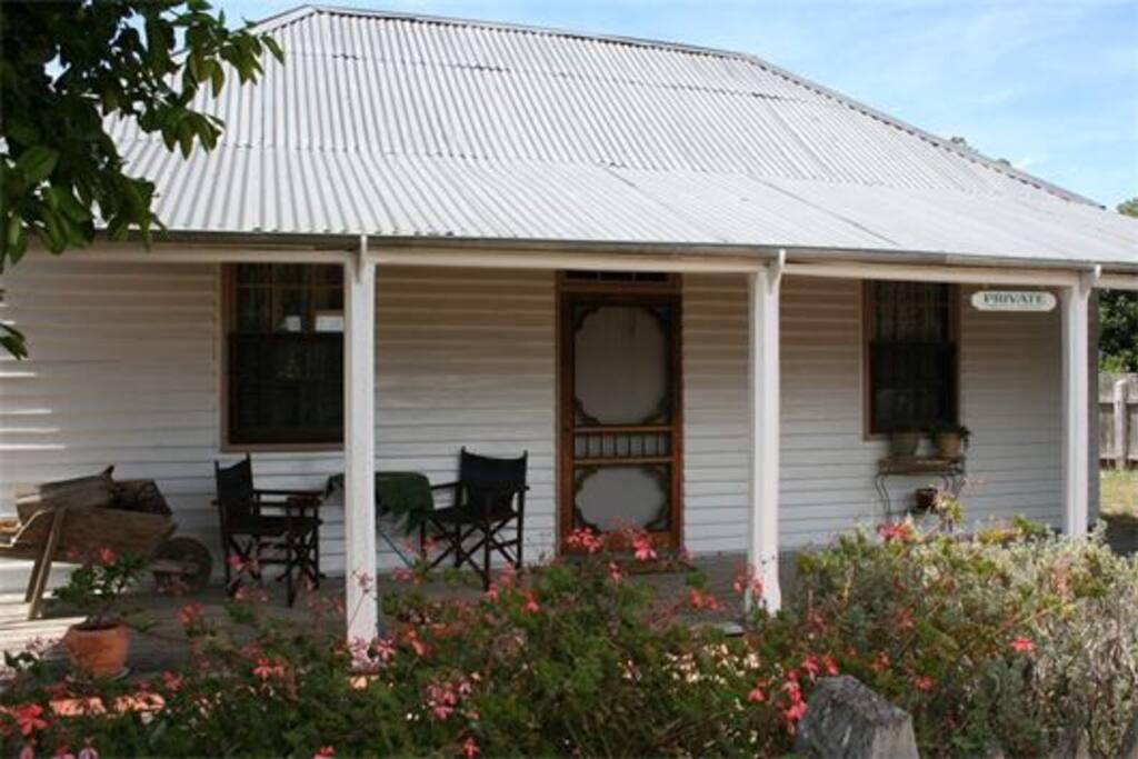 Enjoy a glass of a local Coonawarra wine on the verandah