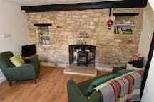 Lounge with woodburner, DVDs, books on local walks and wildlife, maps