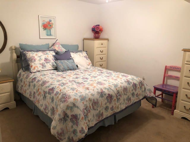 Second bedroom with a large closet and a very comfortable queen size bed.