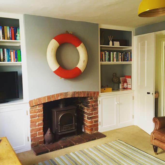 Wood burner in sitting room.