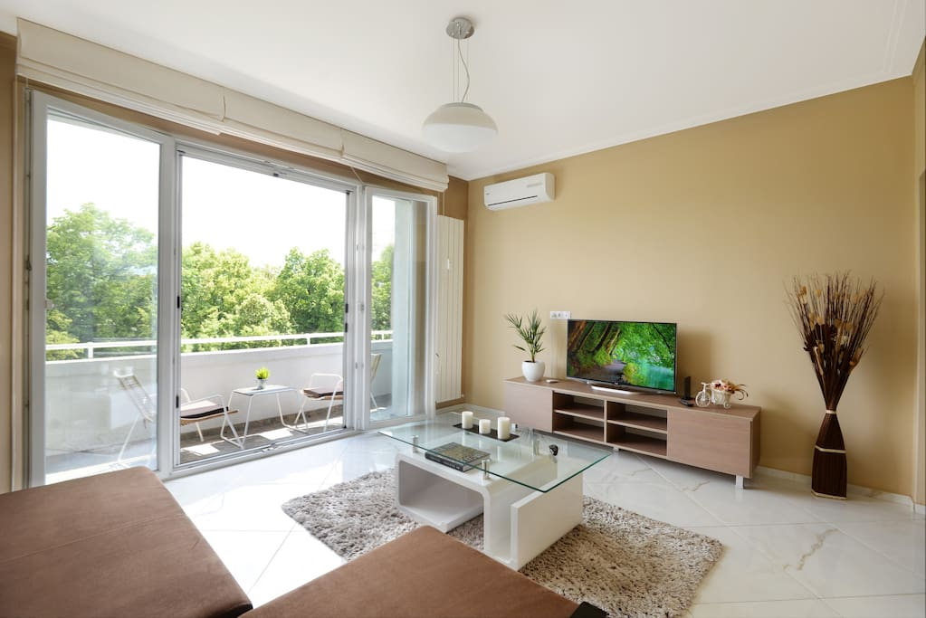 Living room and the great view with opened windows