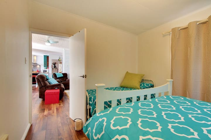 Double bed and small single, double glass doors opening onto the back verandah