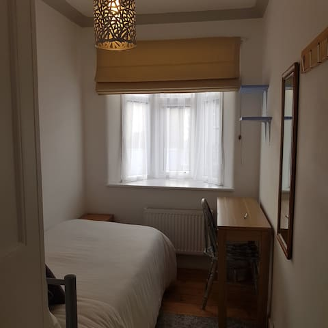 Single room with a single bed.