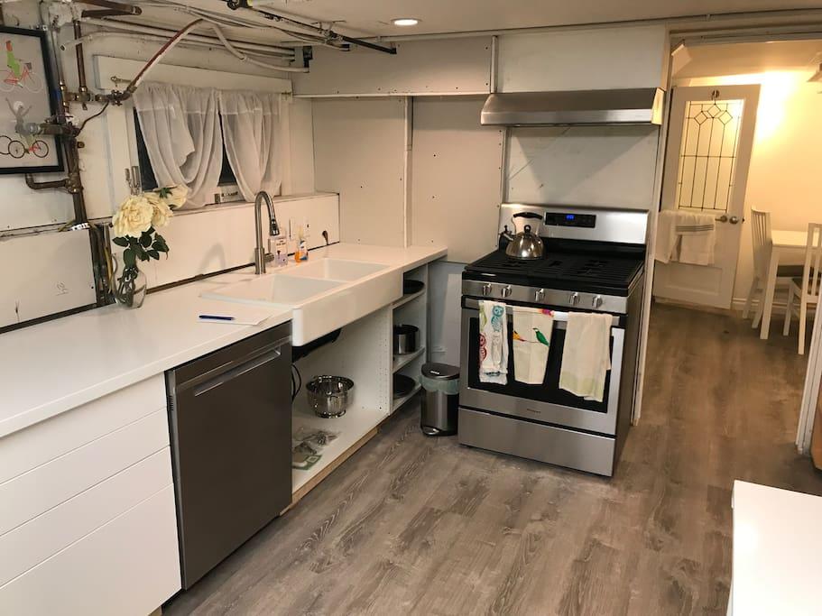 Quartz counter, stainless range/oven, dishwasher, and fridge (not shown)