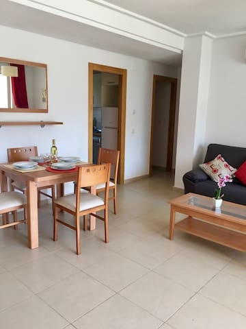 Bright and airy sitting room with dining table and 4 chairs, new 3 seater sofa and armchair. Full air con.