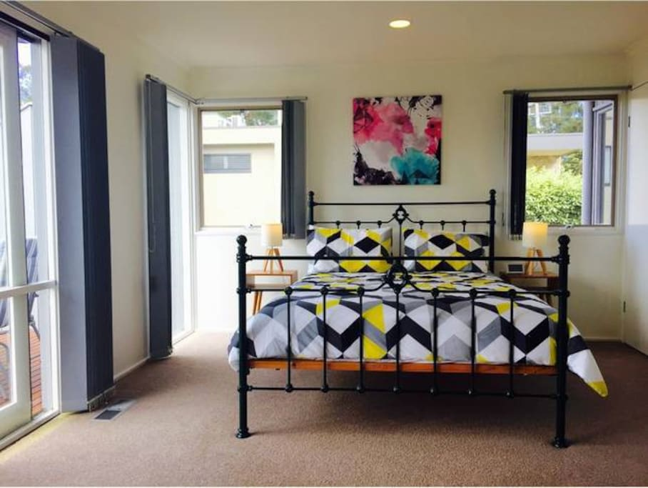 Master bedroom with direct access to outdoor deck. ensuite. built in robes.