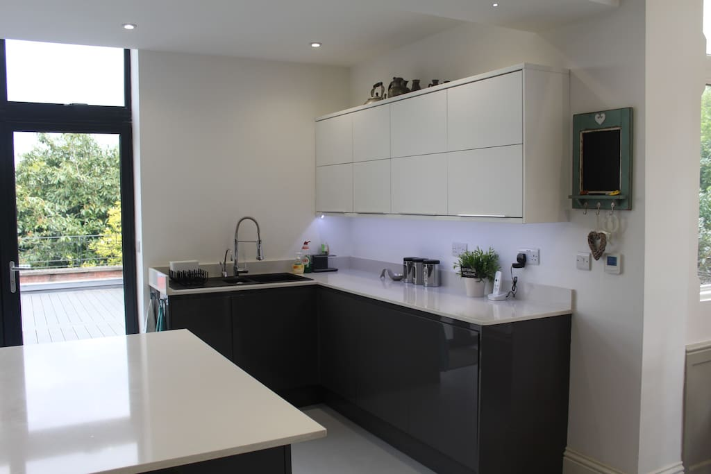 Kitchen washing up area including hot water and filtered cold water tap