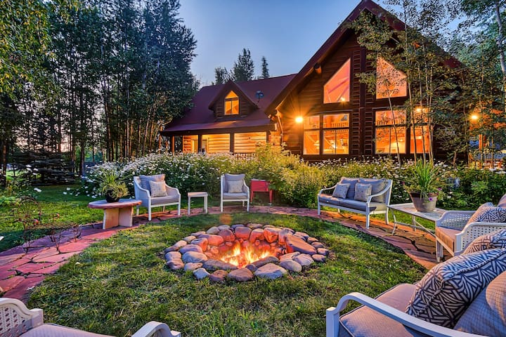 Luxurious creekside home w/ a pool table, foosball, & an outdoor firepit
