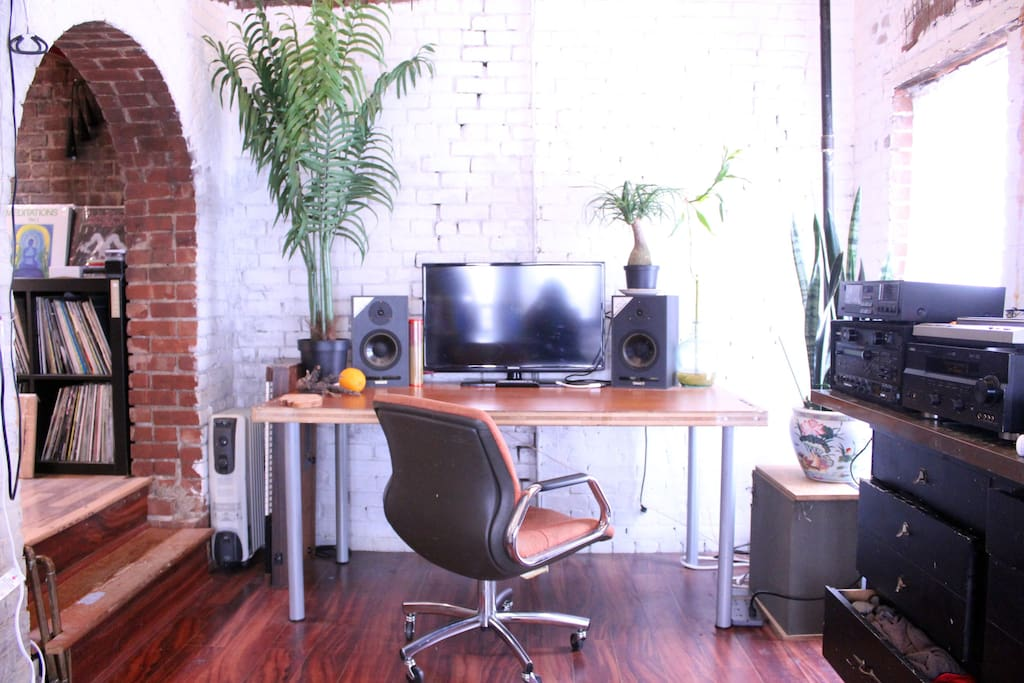 Workspace. Plug your laptop into the flat screen and sound system, plenty of open desk space.