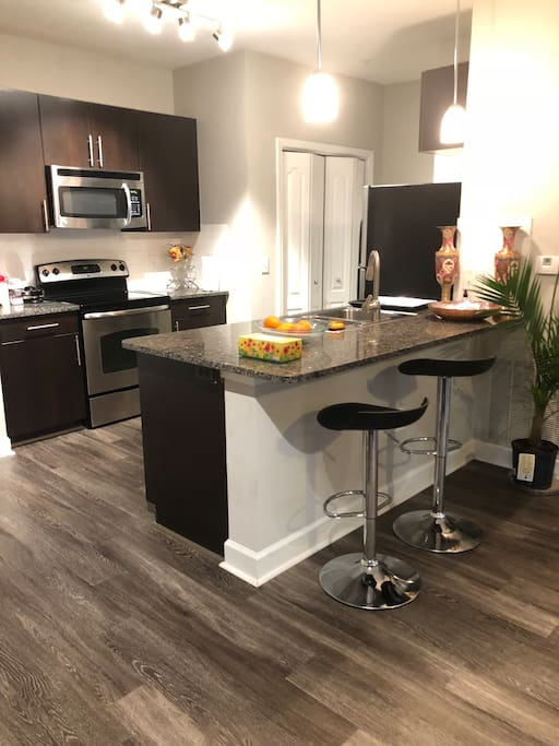 A snapshot of the occupant free private flat (apartment) with stainless still appliances, full size washer and dryer with detergent and dryer sheets, and fully equipped (cooking and dining ware) kitchen. It is much larger than pictured.  Come on and view more...