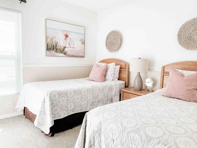 Tastefully decorated guest bedroom with comfortable accommodations. For you convenience a private TV in each room.