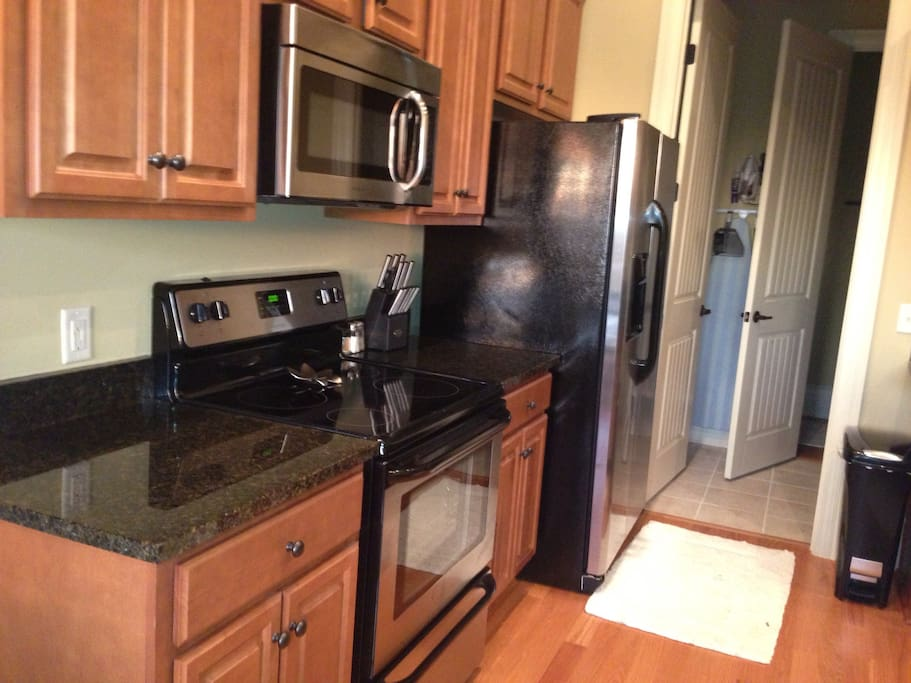 Full size kitchen with all amenities of home for 10 guests.
