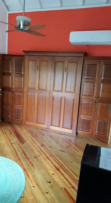 Murphy bed closes up during the day if you need additional space.