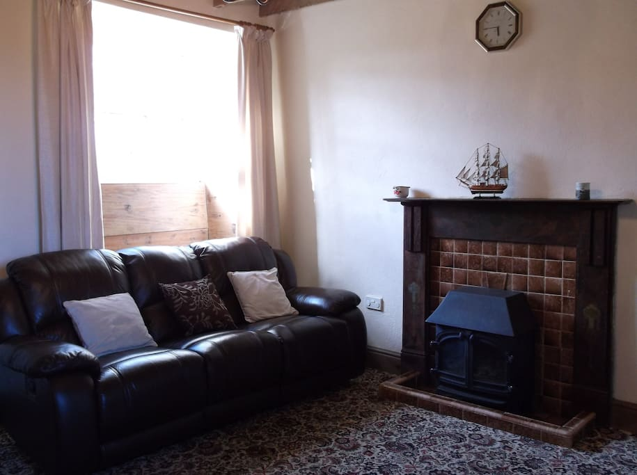 comfortable dining/sitting room.Gas fire & electric heating.