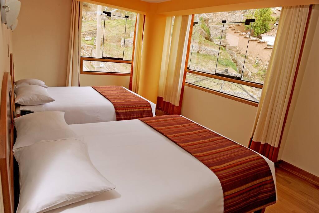 Habitación twin con camas confortables