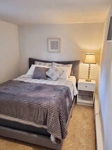 Bedroom #1 has a queen size bed.