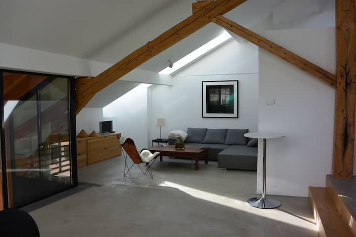 Modern apartment (160m2) in an old village house.