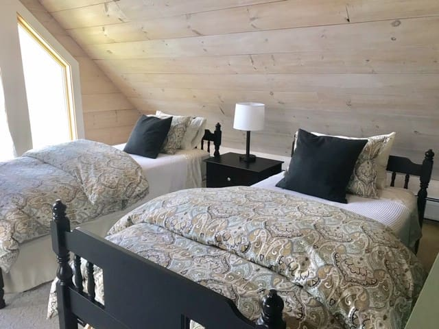 Bedroom 2: Twin beds in sunny loft - can convert to a king