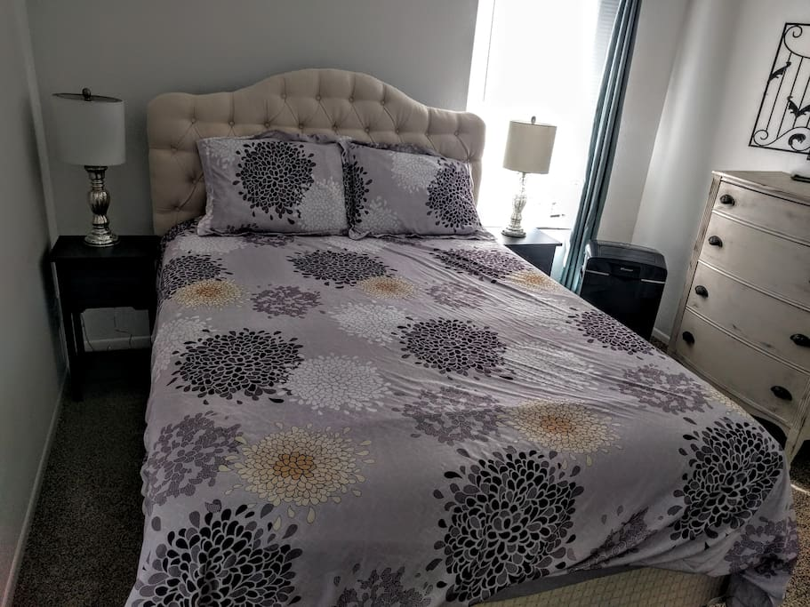 Extra soft sheet in a queen bed & air conditioning unit for comfort.
