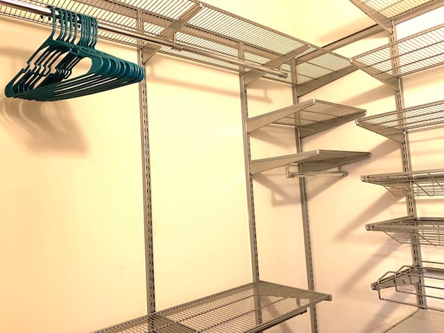 Large walk-in closet with plenty of hangers