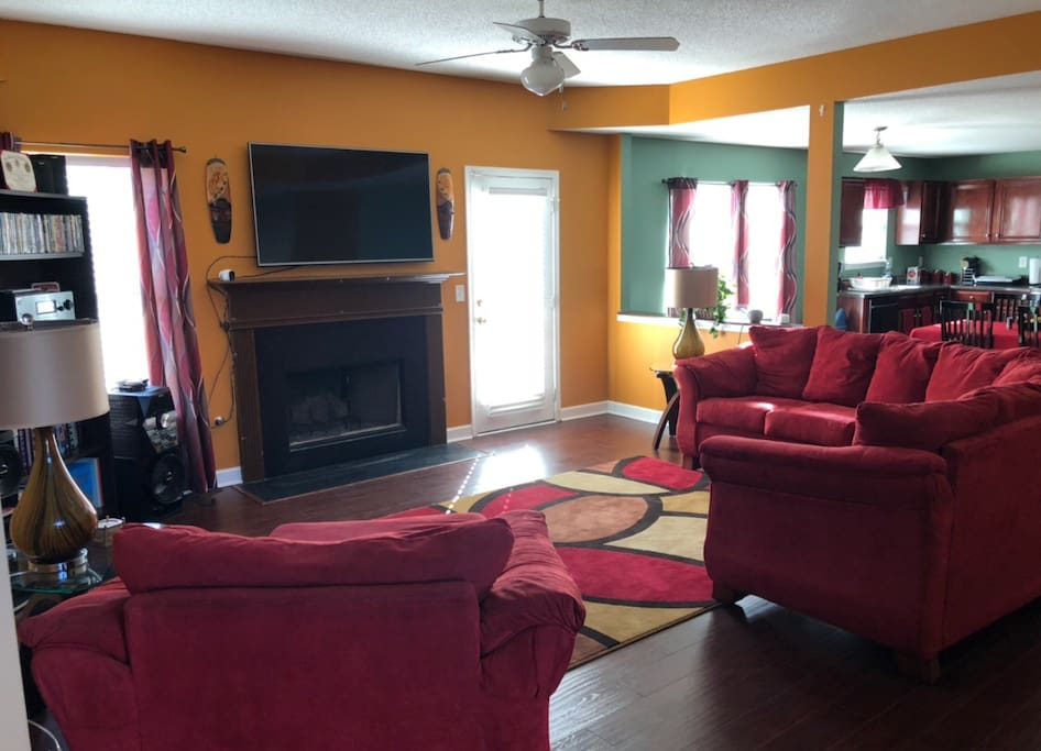 Family room with fireplace, Bluetooth player, and 60 inch smart TV with surround sound.