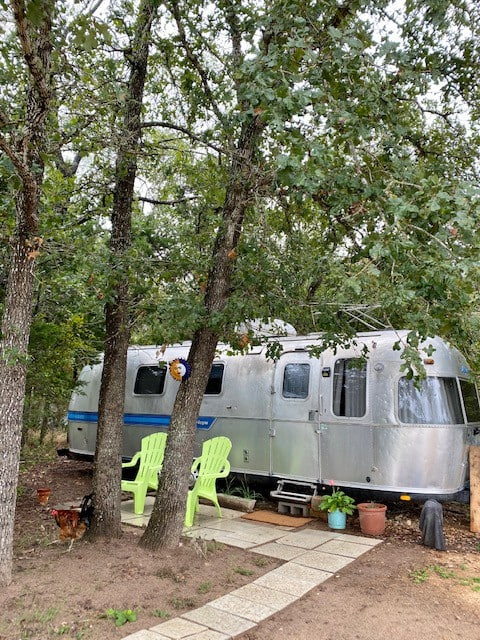 Airstream in the Country in a Pocket of Trees
