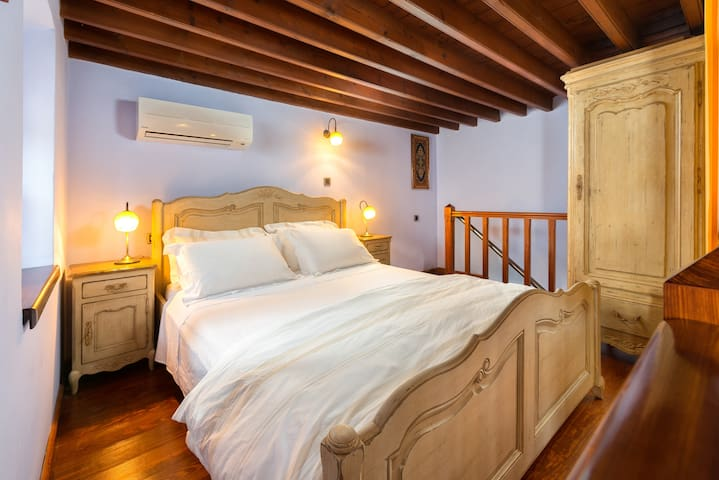 This is the main bedroom. All bed linen are organic and hypoallergenic. Slippers and quality Greek toiletries are provided at no additional charge.