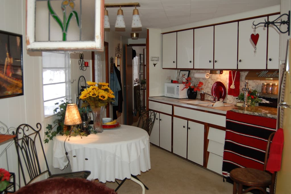 Galley kitchen with full refrig, microwave - no stove