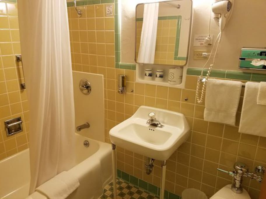 Original tiling in private bathrooms with tub and shower. Shampoo, conditioner and soap all provided.