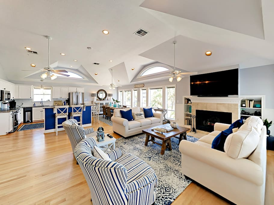 A pair of plush sofas and 2 armchairs furnish the inviting living room.
