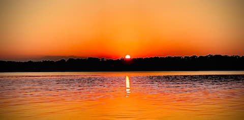 Quiet lake front log cabin with amazing sunsets!